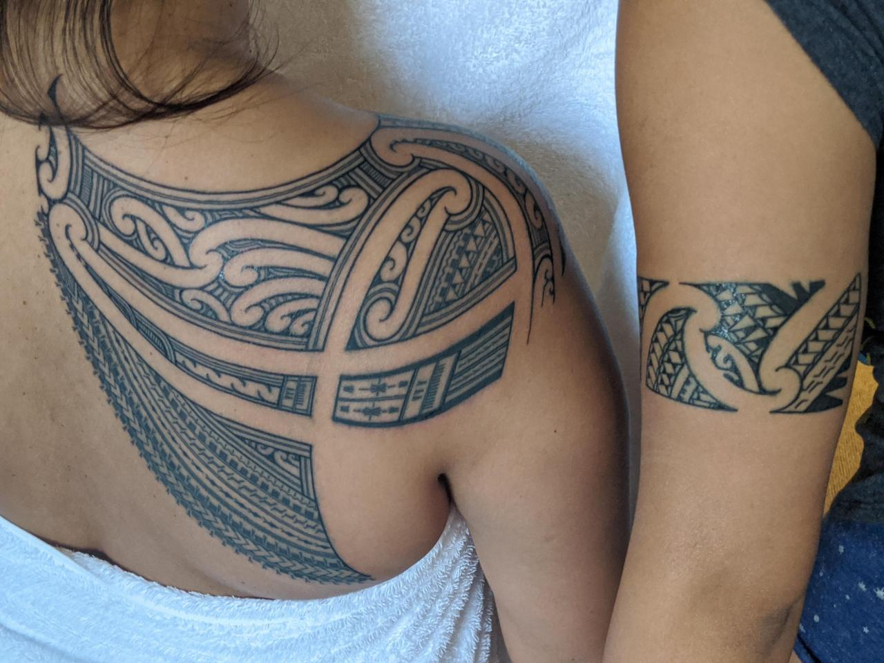 My back tattoo & my sister's arm tattoo done by Andy @ Taupou Tatau, New Zealand