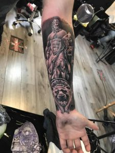 Hercules Fighting Cerberus With Nemean Lion Face on Wrist. Done by Oscar McDevvit of Rock N Roll tattoo Studios Glasgow. Part of a full greek mythology with my outer arm being Hades with Charon the Ferryman