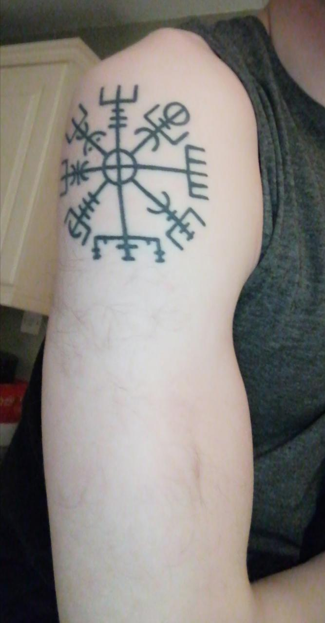 Looking for suggestions on developing this basic runic tattoo on Upper arm.