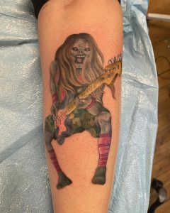 Artist: Tim Brewer, Blueprint Gallery, Hadley MA. My dad lost his leg in a motorcycle accident in 2010. A pretty kickass tattoo of Iron Maiden's Eddie slappin' da bass was also lost that day. I decided to bring that shit back from wherever your limbs go after they're amputated. Up the irons.