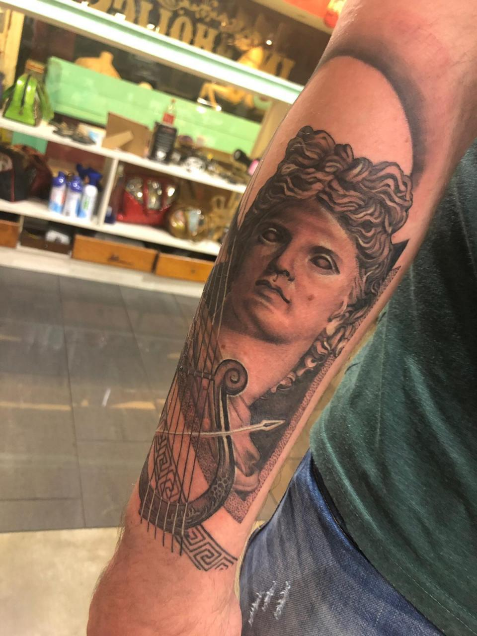 Got this tattoo of the greek god apollo a few months back. Looking to continue at other spots on my arm, any ideas or suggestions?