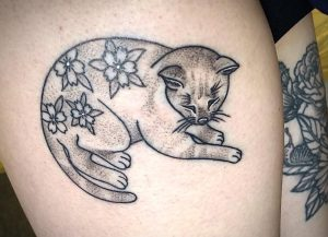 I lost my kitty almost a year ago so I got this little piece on my leg where he used to nap. Done by Cambria at Magnetic Tattoo in Fort Collins, CO