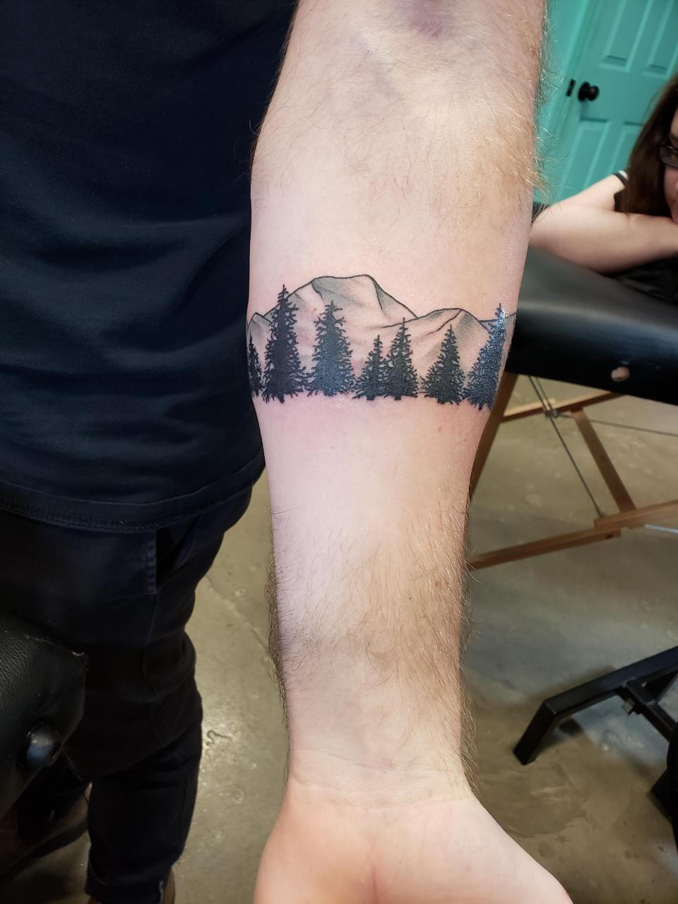 First tattoo, arm band of the sister mountains in Bend, Oregon. Done by Jelena Wolves in Richmond, VA