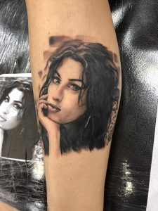 crazy Amy Winehouse portrait on my right leg. done by Adam Loomis at Midtown Tattoo in KCMO