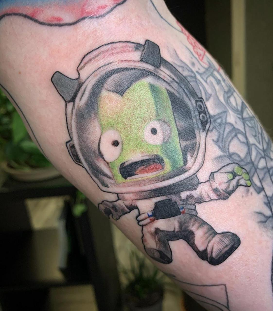 New addition to my in progress nerd sleeve. My arm is filled with references to my favorite video games through my life. This here is Bob Kerman from Kerbal Space Program. Amanda Leitch - White Rhino Collective Renton Washington.