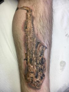 My father passed away so I had his saxophone put on my leg. 1972 Selmer Mark IV. Dan Grueling, Human Condition Tattoo, Pembroke NH