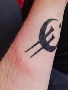 I got this tattoo 9 days ago. The tattoo itself is looking great, it doesn't hurt, isn't swollen, it's flaking but that is normal and I love it overall. However my arm is still red next to the tattoo, but not on it. Is this normal?