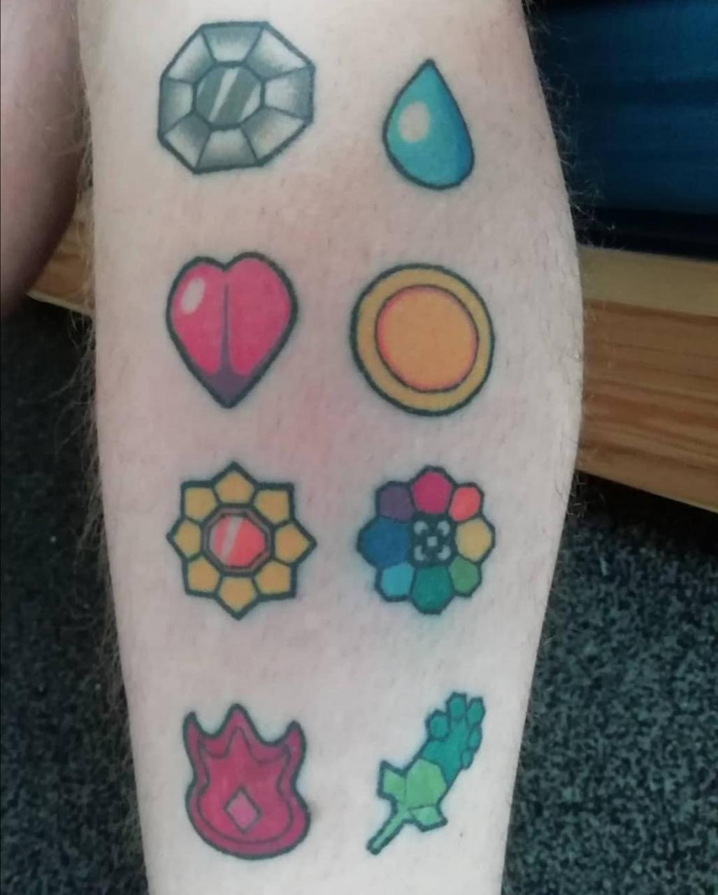 Kanto badges from Pokémon on my left leg this picture was taken about one year after they had been done.