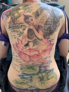 Buddha & Jungle themed back piece done by Heidi Garner at Heartco Ink, Boolarra, Victoria, Australia. More has been added to shoulders and working in a left rib piece to cover writing.