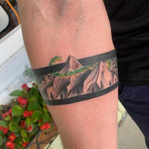 Mountains with northern lights arm band done by Gabe at Heart and Hammer in Dunn, NC.