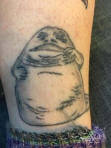 Jabba the Hutt on my leg. This tattoo is over a year and a half old.