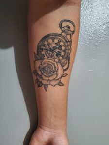 Any idea on what I should get tattooed on my wrist? I want something that would go well with my clock and rose tattoo.