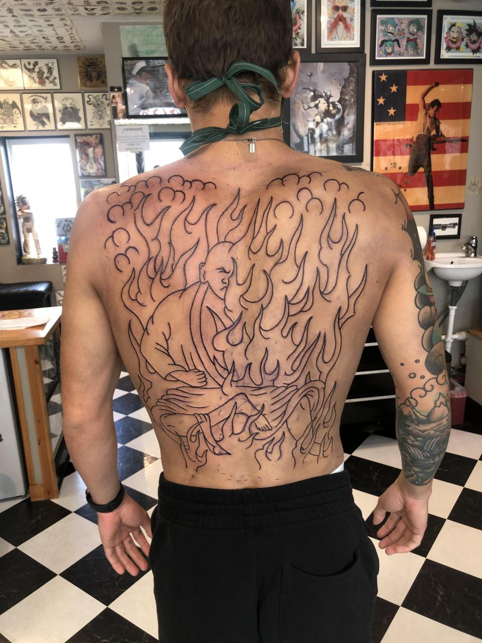 back piece—line work done— Masterwork Tattoo