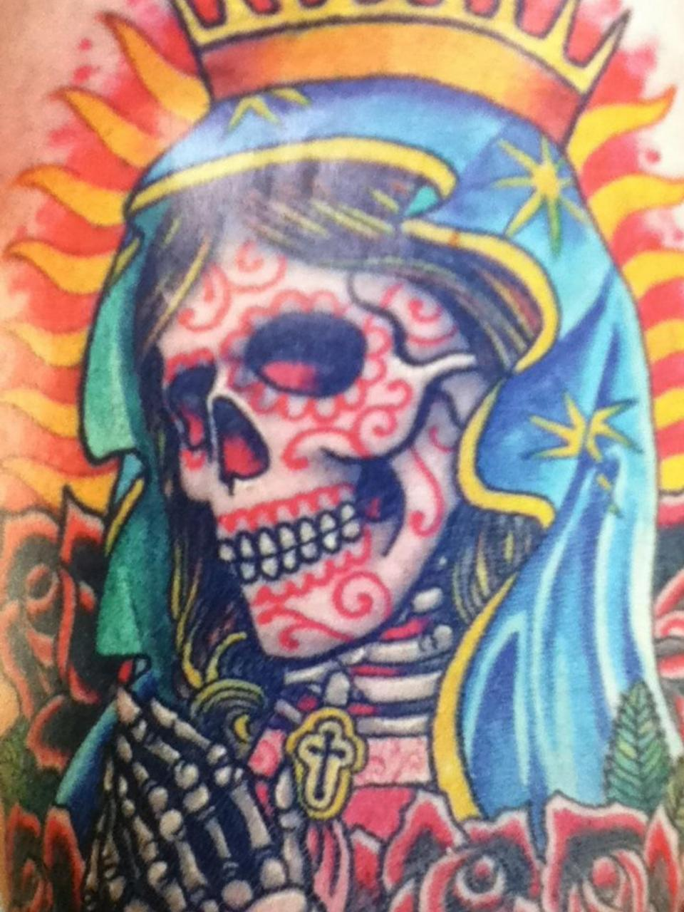Currently looking for somebody to design a tattoo for either my outer arm or behind my calf. Looking for Sugar Skull Virgin Mary with two names underneath in a banner, willing to pay! Looking for something like below.