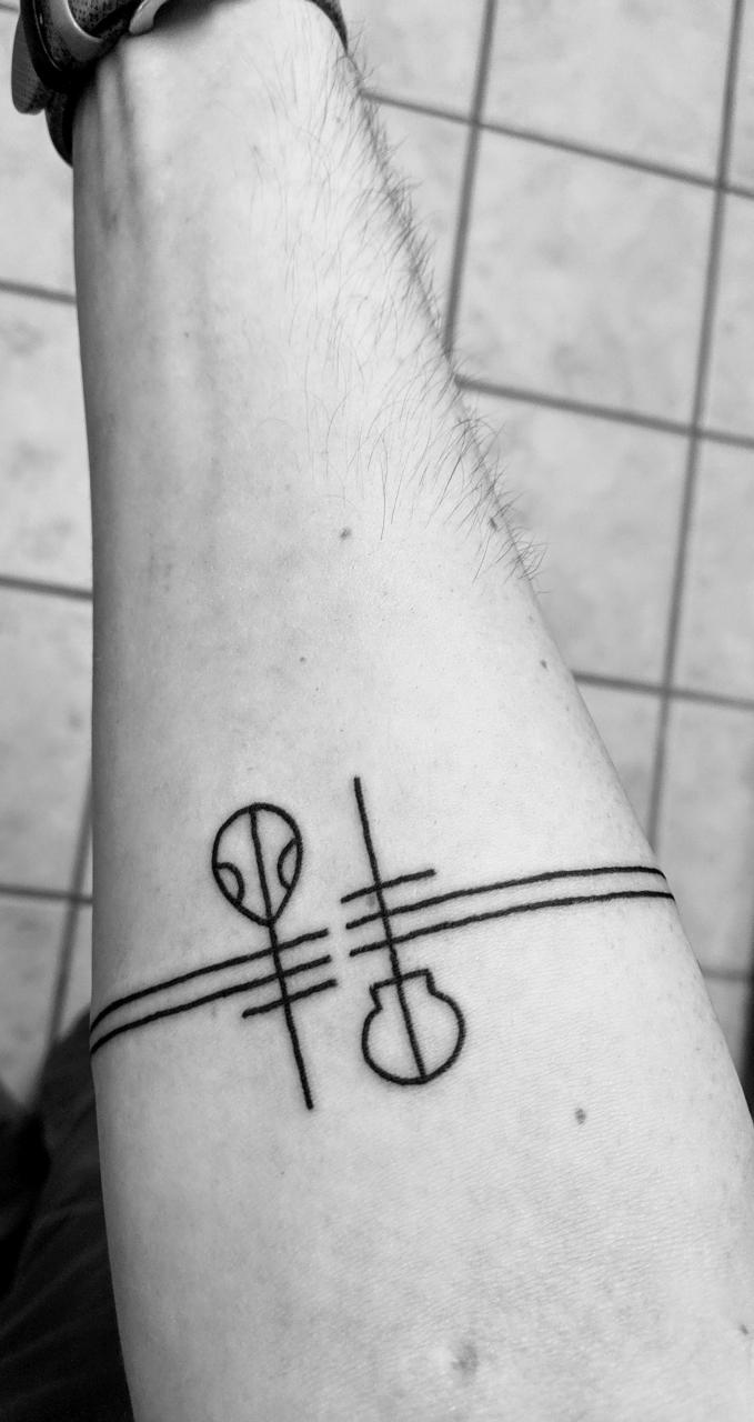 Tattoo conessiours of Reddit: I have two tattoos (one below), but it's lonely. Looking for advice on filling up my shoulder so it's not so lonely