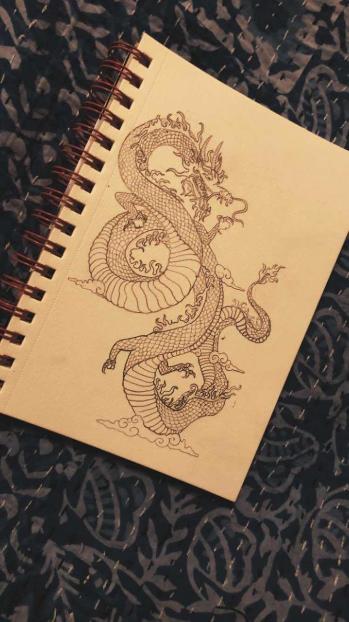 This lil sketchbook dragon is going on my arm Friday!