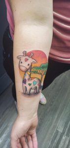 Just got tattoo number 5! So in love with my new friend Raymond the rainbow giraffe.