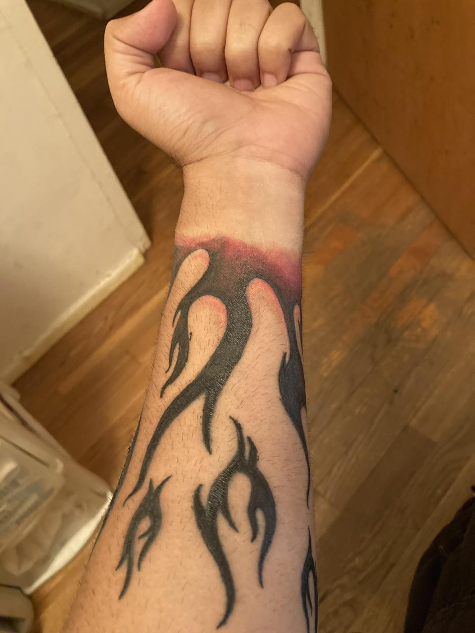 Any ideas on what to put in between the flames while still making the original tat visible? It wraps all around my forearm.