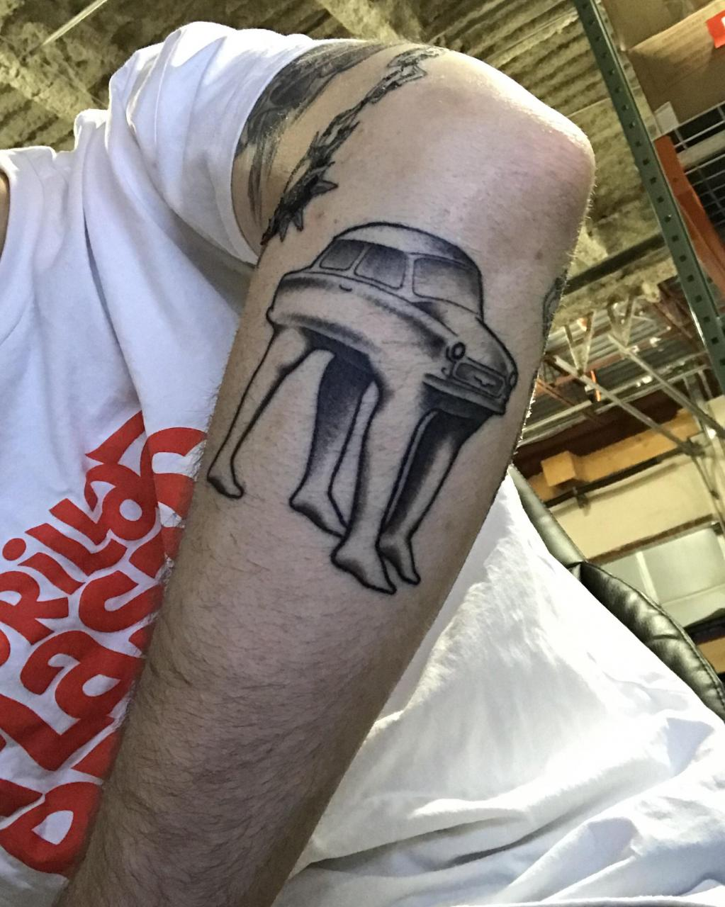 Car with legs done by Marcel at The Black Rose in Pickering, Ontario (healed)