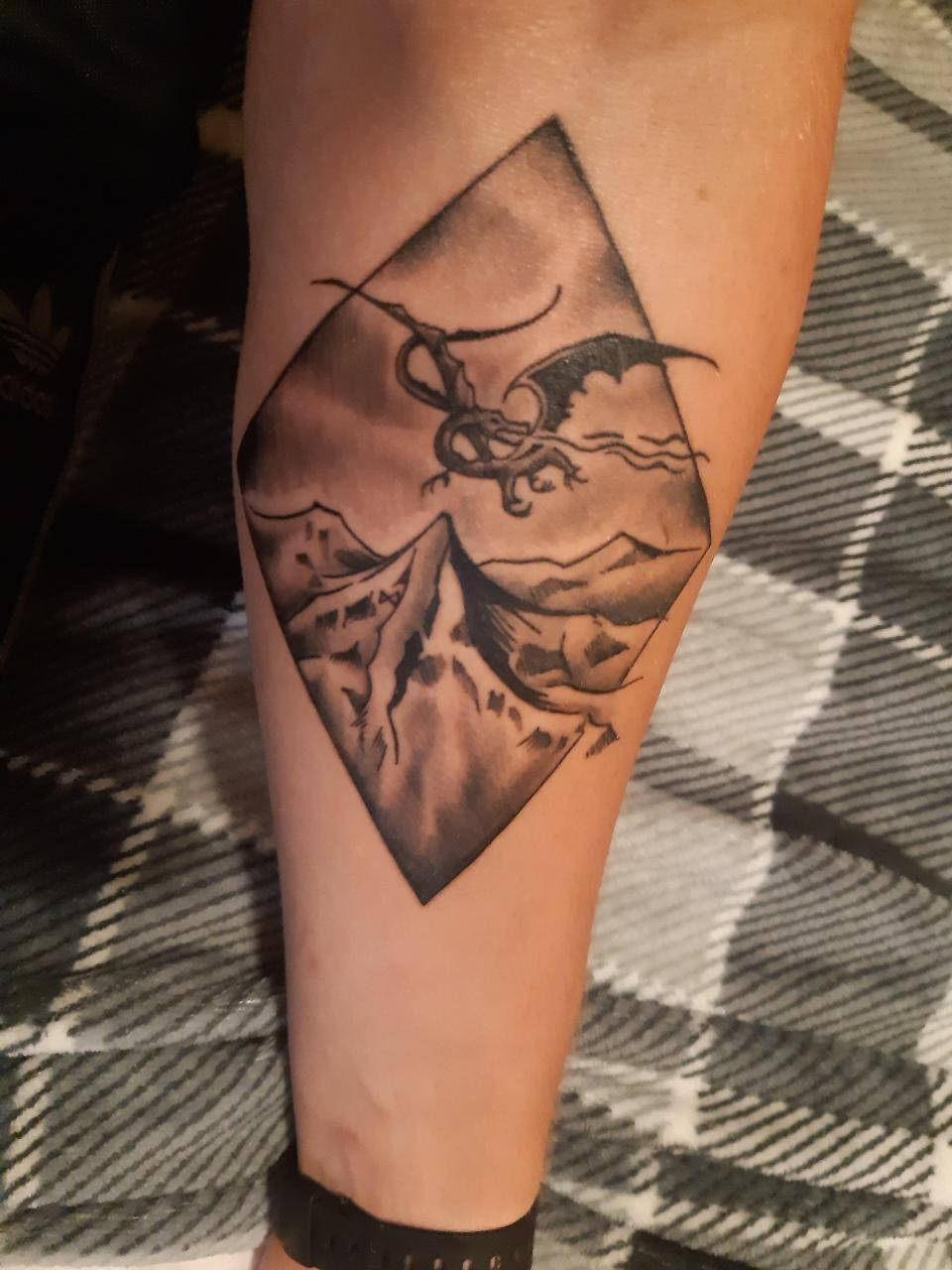 Smaug and The Lonely Mountain (Looks warped because of the way it wraps around my arm, but is actually okay). Grant Mitchell, London, UK
