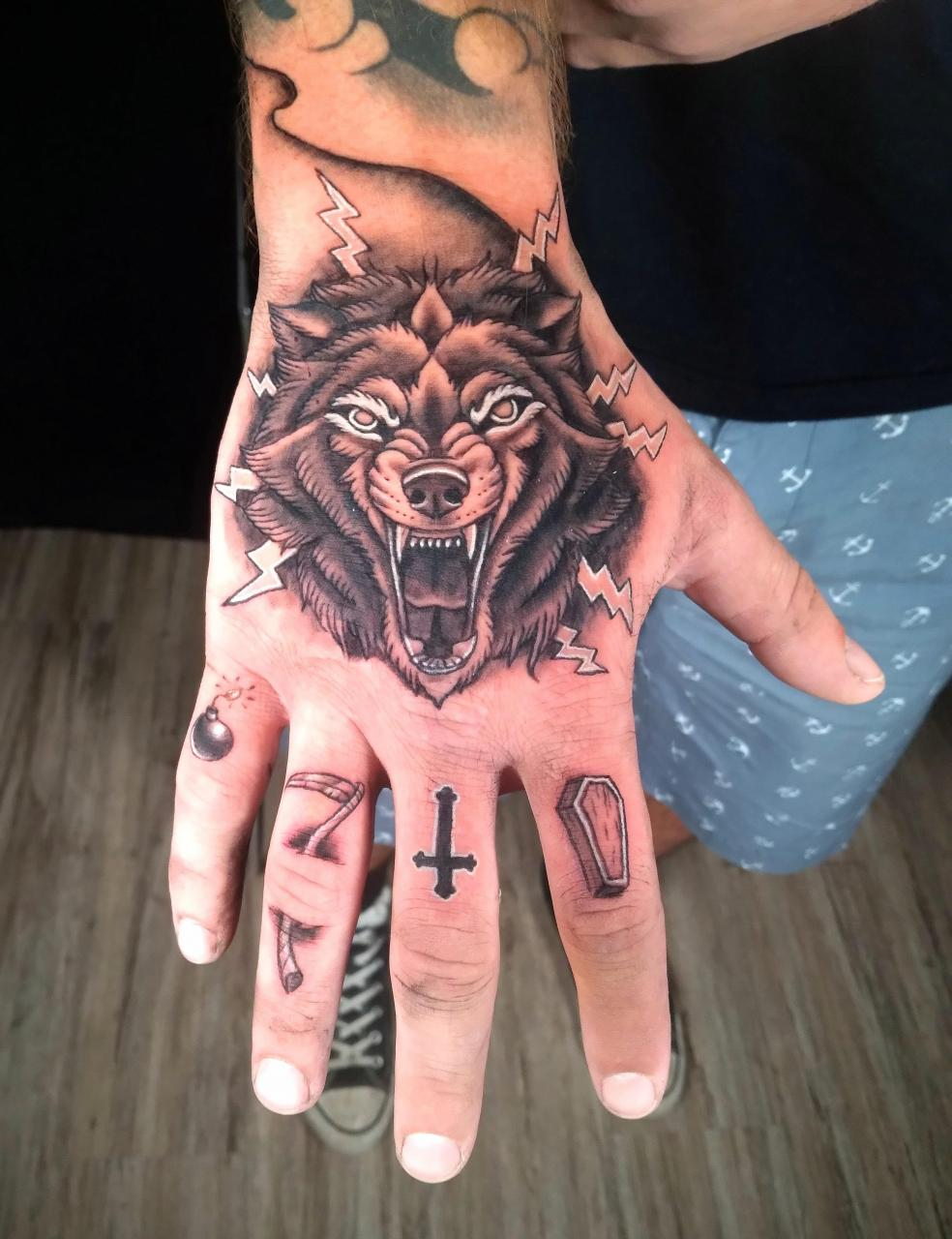 Hand and finger tattoos by Woodrow Wilson Cowher in East Palestine, OH