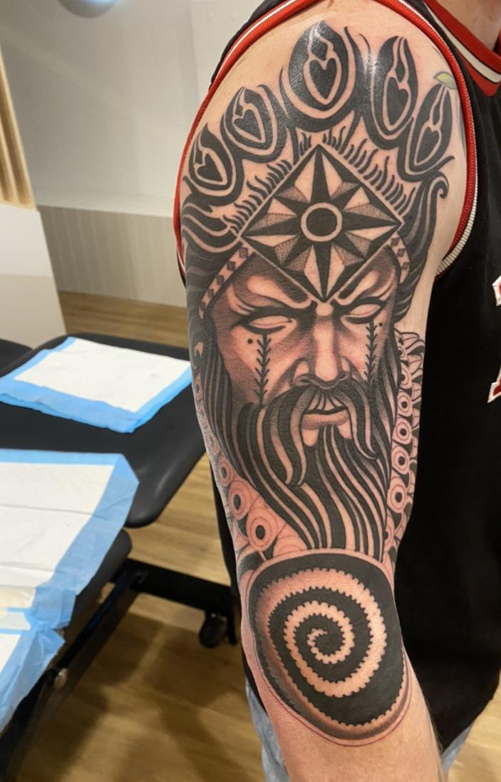 1st session of 2 at UW tattoo, Adelaide. Next session will fill in the form arm and unshaded sections and add some torquoise blue in other sections.