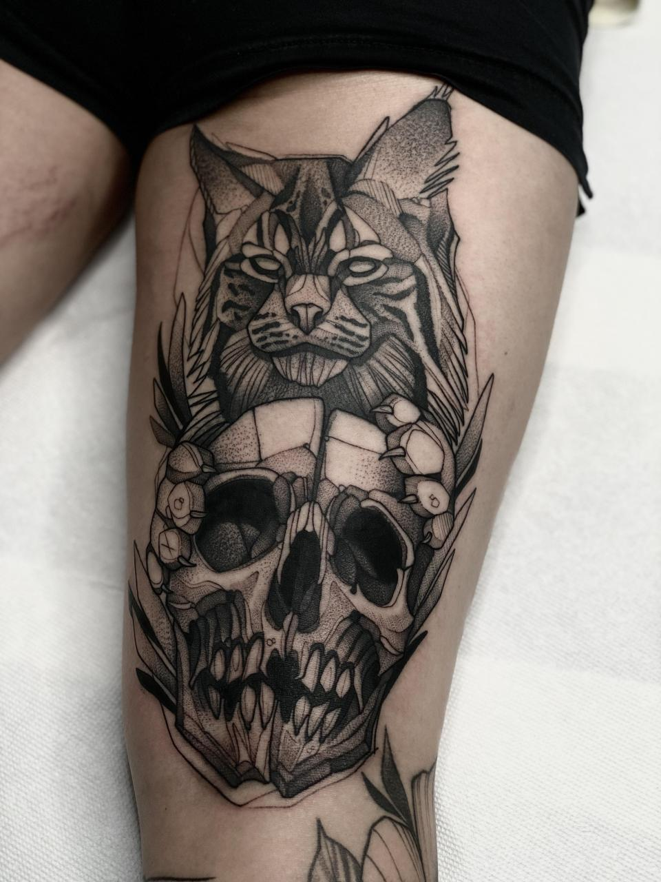 Back of the thigh bobcat and skull piece done by Max LaCroix at Akara Arts in Milwaukee, WI