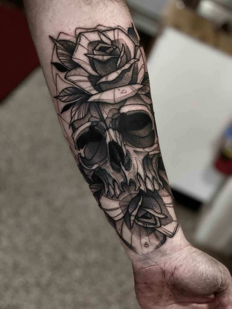 Skull and roses forearm piece done by Max LaCroix at Akara Arts in Milwaukee, WI
