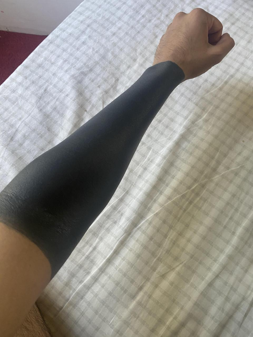 What can I get on my upper arm that would not look bad with the blackout? I don't want to get my upper arm blacked out as well. Please, any suggestions would be awesome!