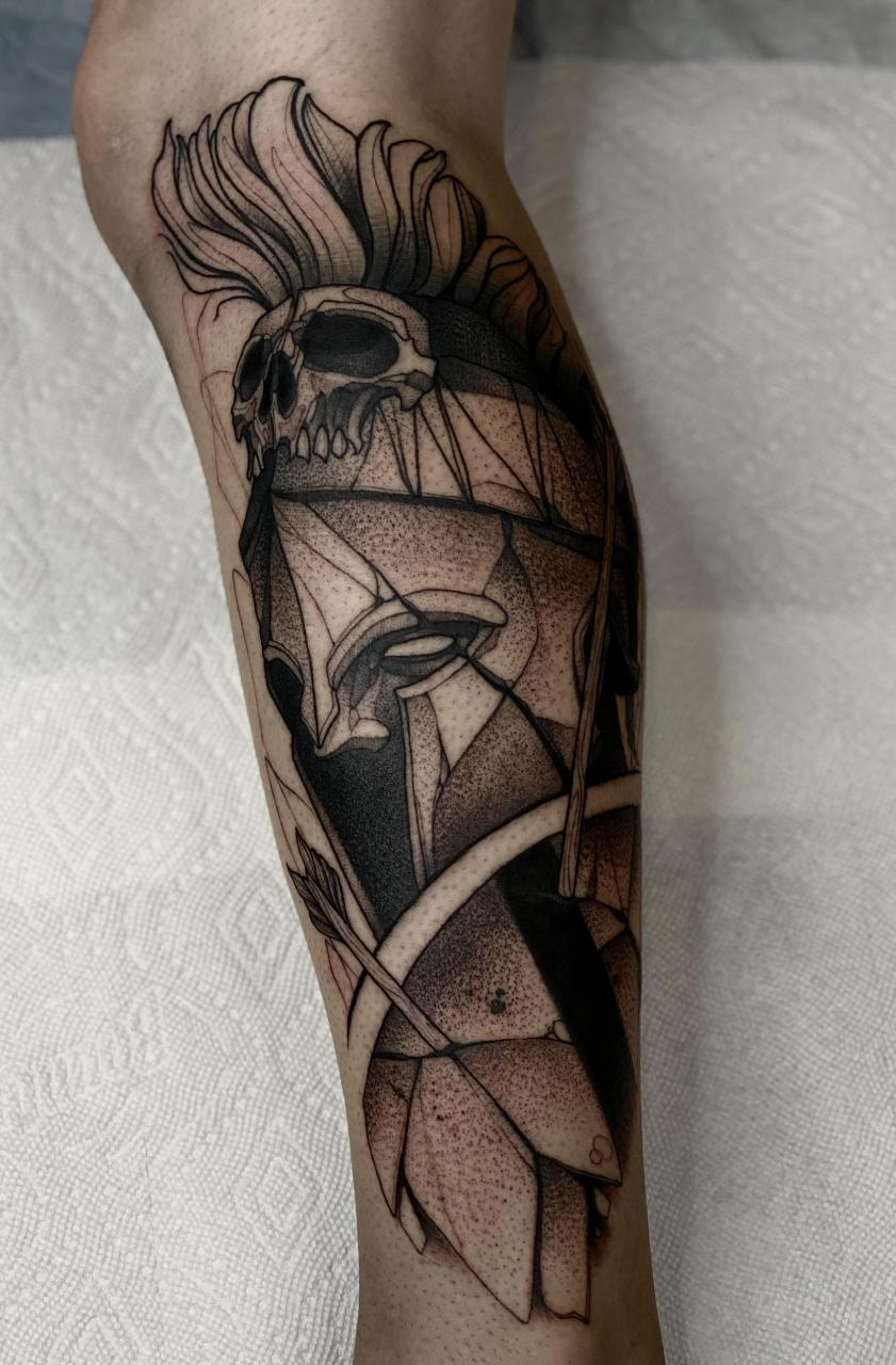 Spartan calf tattoo done by Max LaCroix at Akara Arts in Milwaukee, WI