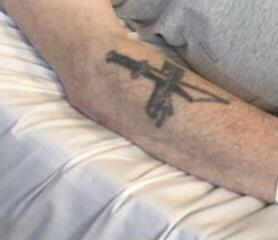 Can anyone define what this design is on my grandfathers arm? He passed away this year and never really got to ask what it was but would like to know to get replica.Thanks