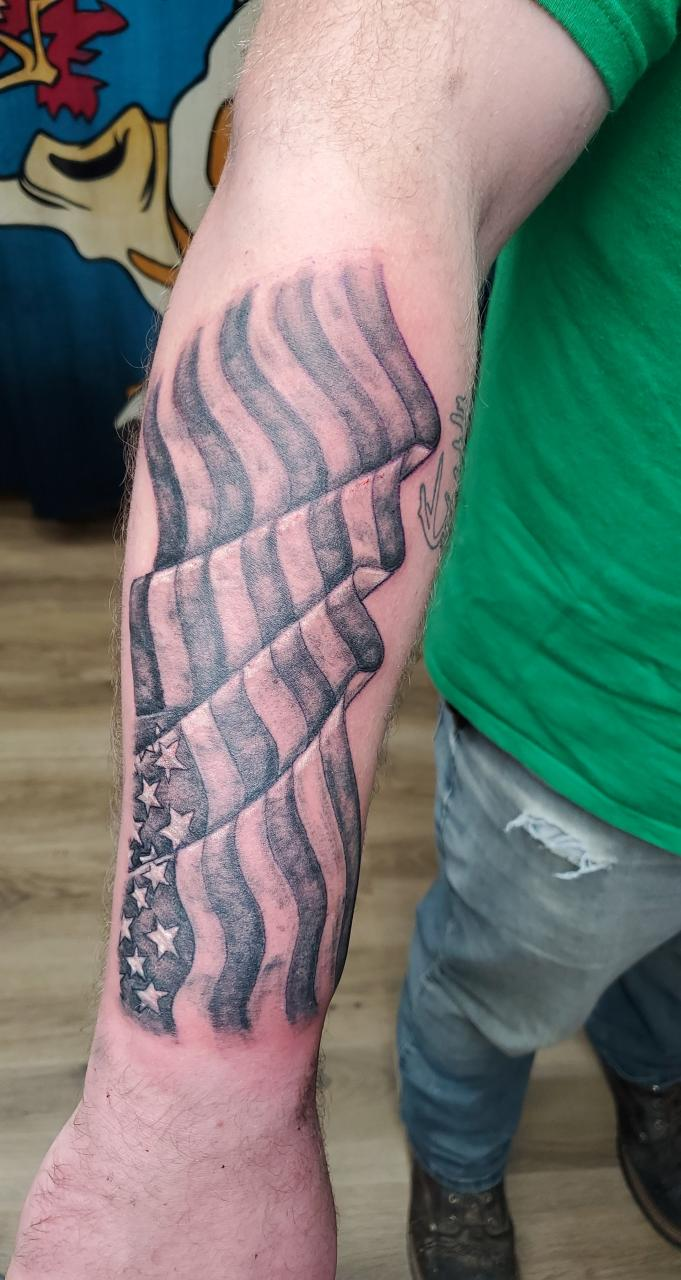 Thoughts? Wanted the flag to be facing me with the tattoo on top of my arm. Already starting to think it should have been the other way around. Am I crazy?